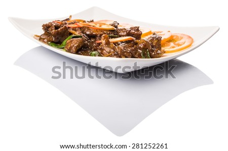 Malaysian dish stir fried beef meat with oyster sauce and tomato slices in white plate