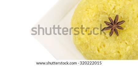 Malaysian dish Yellow Glutinous Rice or locally known as Pulut Kuning on white plate