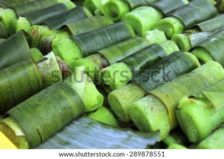 Malaysian Kuih Lenggang on sale at a market - stock photo