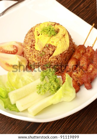 Malaysian traditional dishes: Fried Rice with Chicken Satay - stock photo