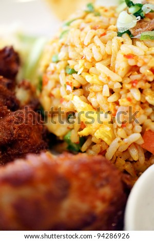Malaysian traditional dishes: Fried Rice with Fried Chicken - stock photo