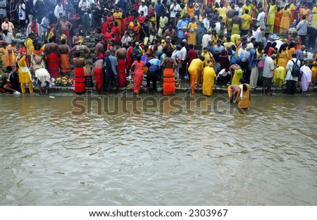 Malaysians of Hindu devotees prepare for pilgrimage to the sacred Batu Caves temple in Kuala Lumpur during Thaipusam festival, 2006. - stock photo