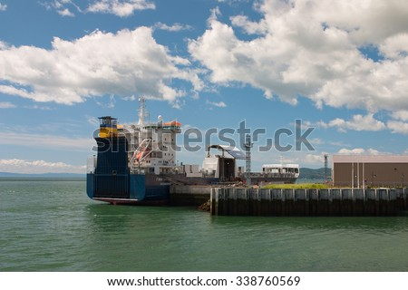 Malbaie, Canada . July 16,2007 : Empty container ship in Malbaie harbor, Canada. Gross tonnage:20,851 tons,  Lengt: 178 m Beam:24 m Draught:6.5 m