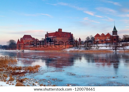 Malbork castle in Poland with reflection in Nogat river