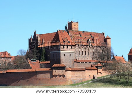 Malbork castle in Pomerania region of Poland. UNESCO World Heritage Site. Teutonic Knights' fortress also known as Marienburg. Nogat river.