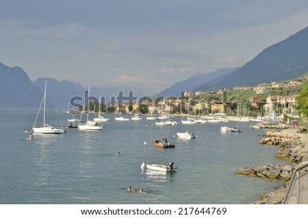 MALCESINE, ITALY . AUGUST 7: Some people sunbathing on August 7, 2014  in the lake Garda near the village of Malcesine, Italy.