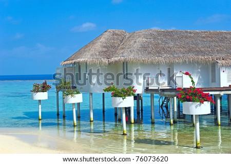 Maldive water villa - bungalows close up - stock photo