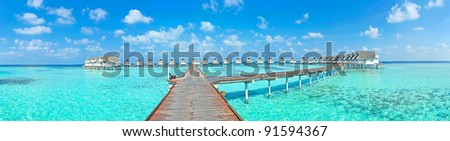 Maldive water villa - bungalows panorama - stock photo