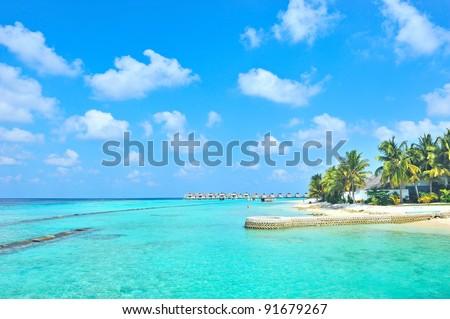 Maldives island and cloudy sky - stock photo