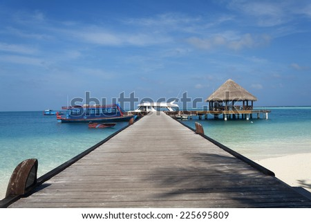 Maldives Jetty Eternity View, whit boat and yacht - stock photo