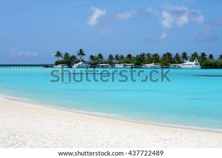 Maldives pier in the lagoon - stock photo