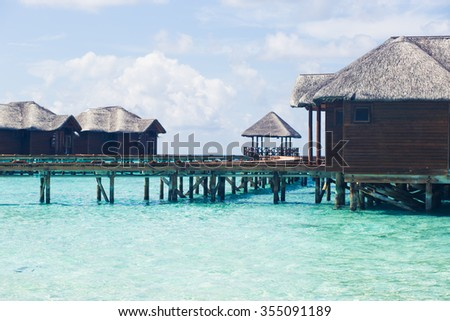 Maldives. view of the houses on the water. bungalow. expensive vacation. Paradise on earth. Indian Ocean. blue water. White sand.
