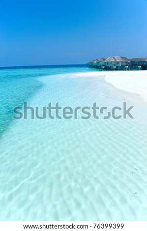 Maldives water villa - bungalows and white beach - stock photo