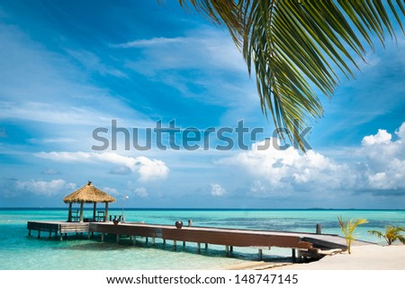 Maldivian house on a tropical island, travel background - stock photo