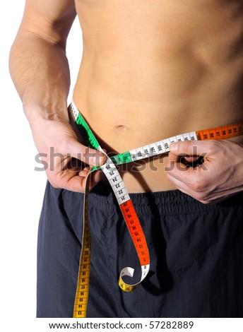 male abdomen with tape - stock photo