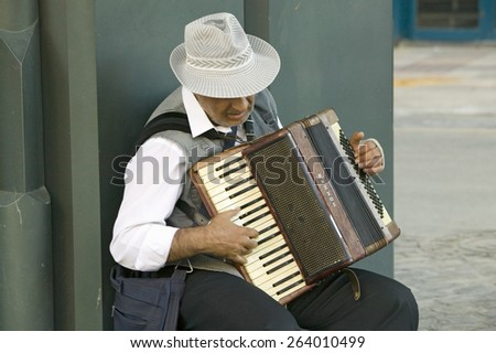 Male accordion player in town center of Sevilla, Andalucia, Southern Spain - stock photo