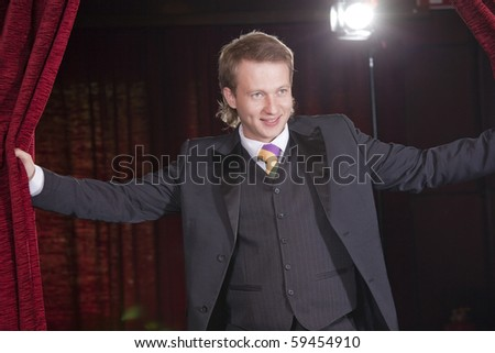 male actor in spotlight on the stage - stock photo