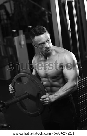 Male adult bodybuilder working out with weight