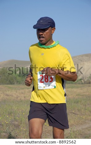 male african-american participant in the Kern River Trail Race - stock photo