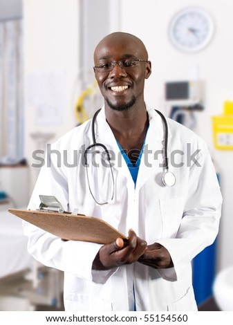 male african doctor in hospital ward - stock photo