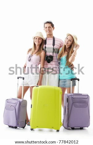 Male and beautiful girls with suitcases on a white background - stock photo