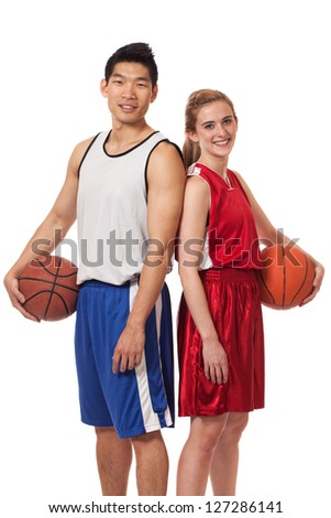 Male and female basketball players. Studio shot over white.