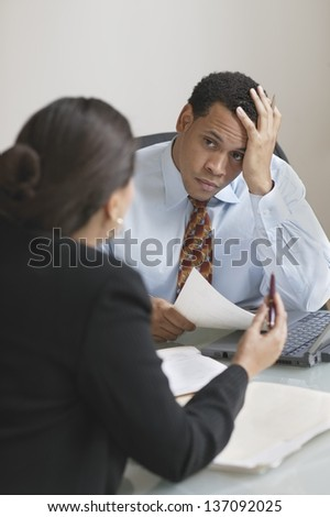 Male and female business partners discussing business - stock photo