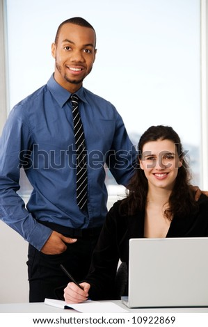 male and female business partners in a window office - stock photo