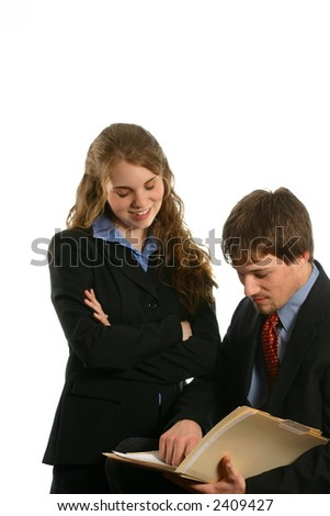 Male and female business people looking at file - stock photo