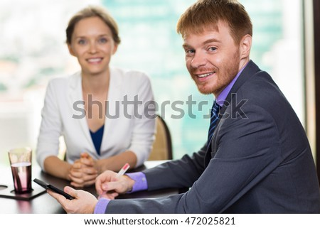 Male and Female Business People Posing