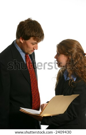 Male and female business people talking about file - stock photo