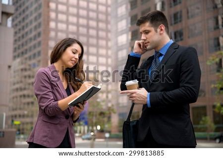 Male and female businesspeople personal assistant secretary taking notes cell phone - stock photo
