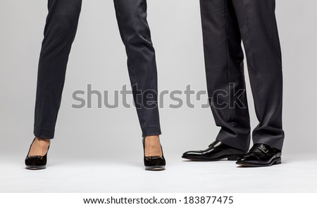 Male and female businessperson's legs - closeup shot