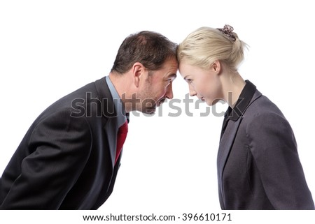 Male and female Colleagues arguing against each other, isolated on a white background. - stock photo