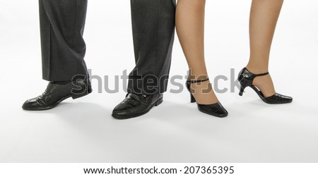 Male and female dancers feet in cha-cha pose standing on white background - stock photo