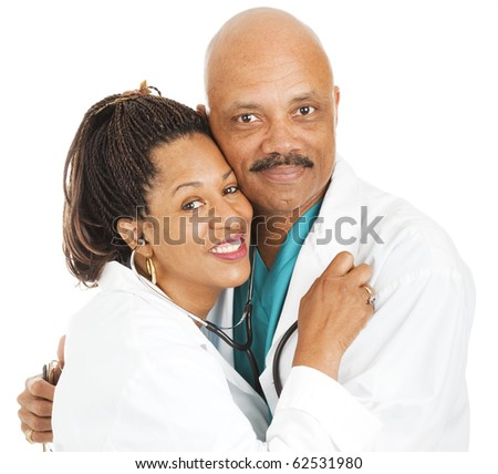 Male and female doctors in love.  Isolated on white.