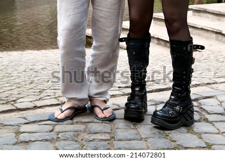 male and female feet in slippers and boots