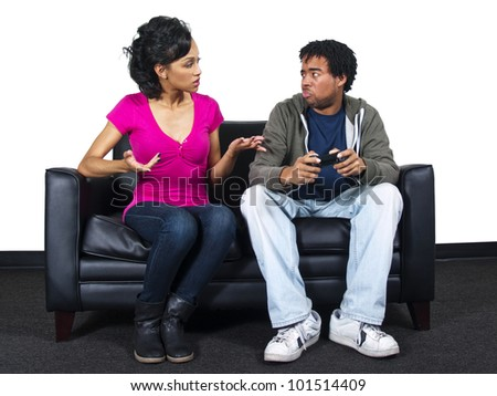 male and female fighting over a video game controller