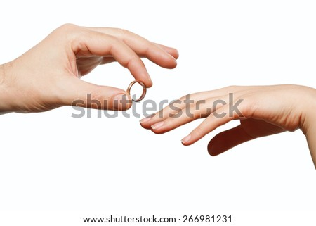 male and female hand with a wedding ring - stock photo