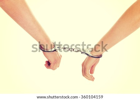 Male and female handcuffed.
