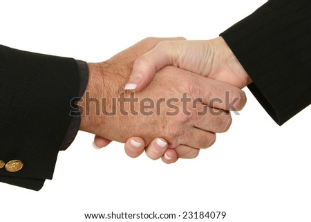 Male and female hands in suits shaking hands.