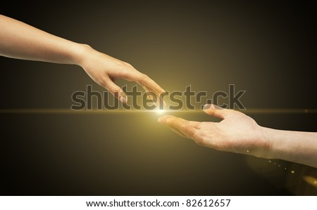 male and female hands (palms) stretch  to each other - stock photo