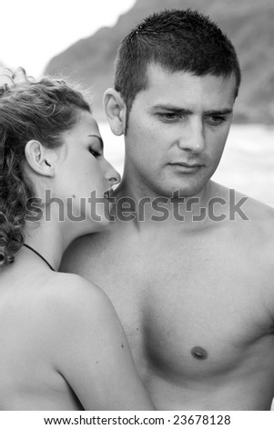 male and female model on the beach - stock photo