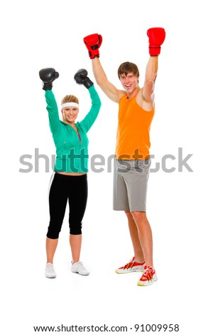 Male and female par in boxing gloves celebrating victory isolated on white