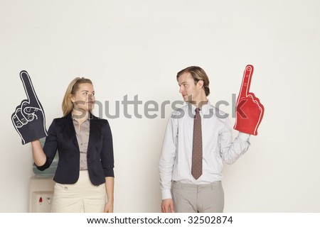 male and female professional standing next to each other - stock photo