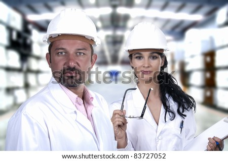 male and female quality control white helmet - stock photo