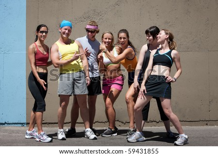 Male and female runners enjoying the fun of running. - stock photo