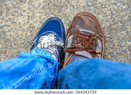 male and female shoe on the pavement - stock photo