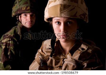 Male And Female Soldiers - stock photo