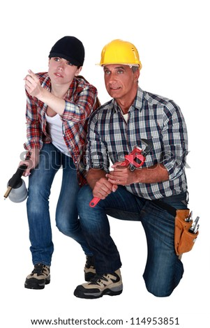 Male and female workers crouching - stock photo